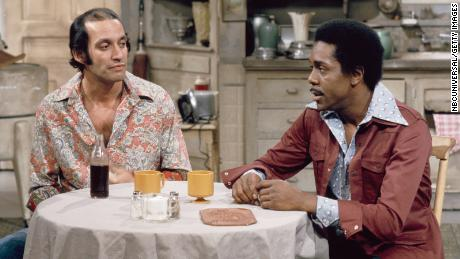 Gregory Sierra (left) as Julio Fuentes' neighbor in an episode of & quot;  Sanford and Son & quot;